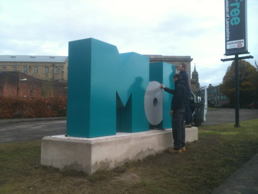 Built up metal letters installation