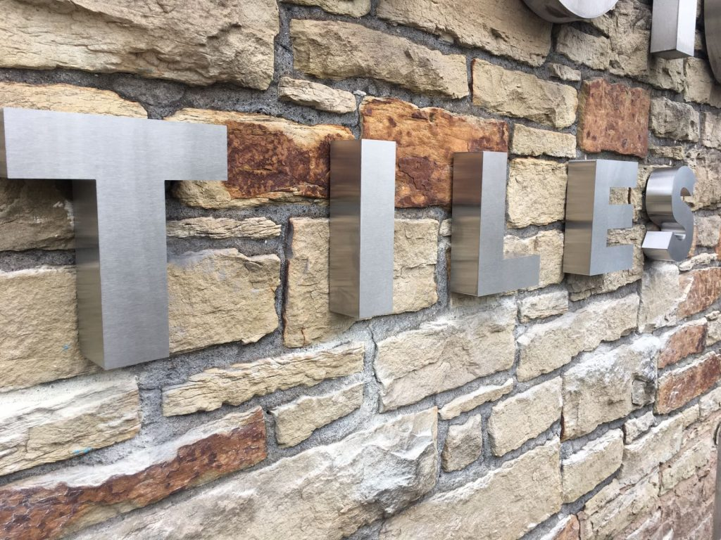 Metal letters for brick wall